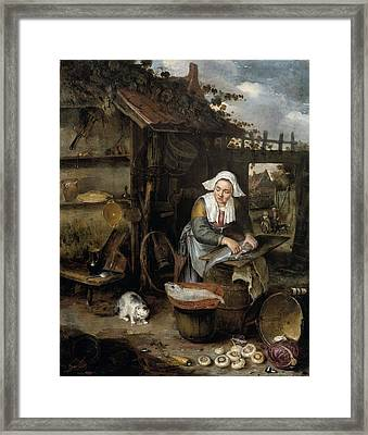 A Housewife In An Inner Courtyard Cleaning Fish Framed Print by Hendrik Potuyl