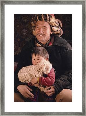A Kazakh Eagle Hunter And His Son Framed Print by David Edwards