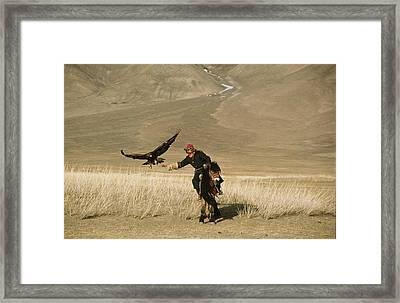 A Kazakh Falconer Hunts His Golden Framed Print by David Edwards