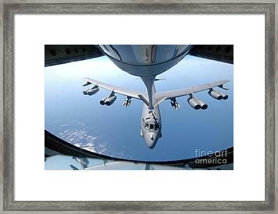 A Kc-135 Stratotanker Refuels A B-52 Framed Print