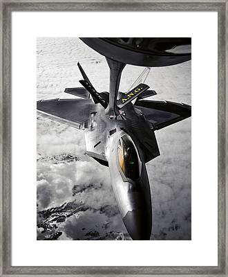A Kc-135 Stratotanker Refuels A F-22 Framed Print by Stocktrek Images