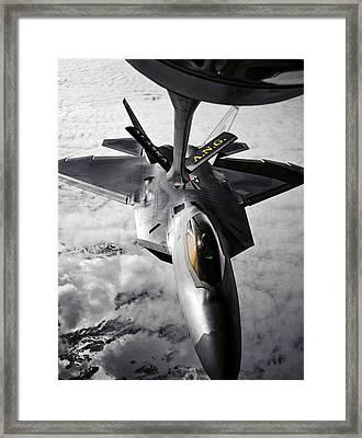 A Kc-135 Stratotanker Refuels A F-22 Framed Print by Stocktrek Images