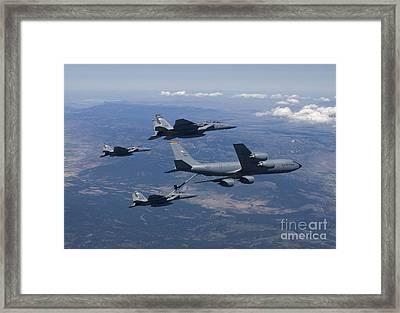 A Kc-135r Stratotanker Refuels Three Framed Print