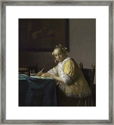 A Lady Writing Framed Print by Jan Vermeer