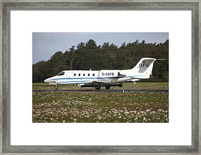 A Learjet Of Gfd With Electronic Framed Print by Timm Ziegenthaler