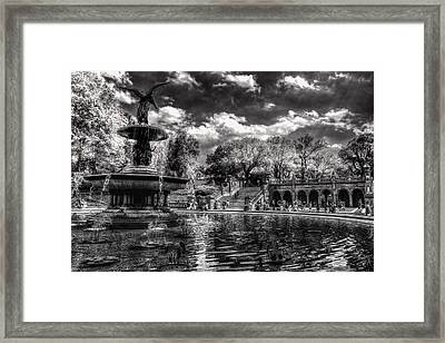 A Lily In Her Hand Framed Print