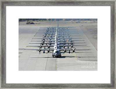A Line Of C-130 Hercules Taxi At Nellis Framed Print