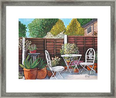A Little British Garden Framed Print