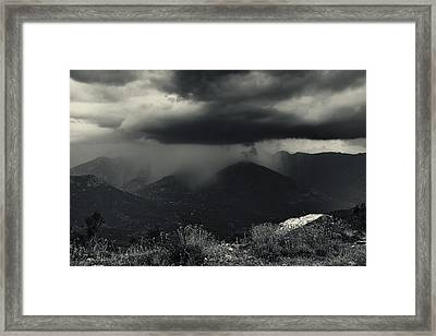 A Little Shower Framed Print by Fabien Bravin