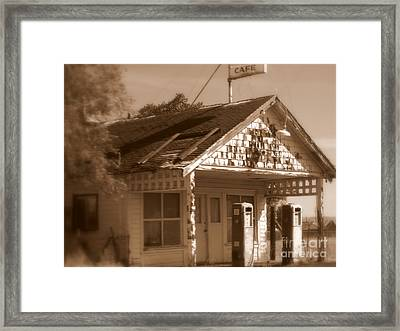 A Little Weathered Gas Station Framed Print by Carol Groenen