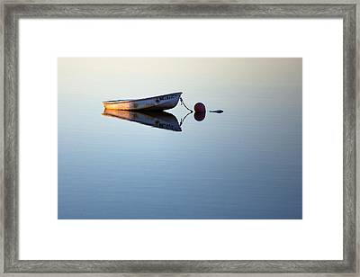A Lone Boat On Calm Waters Framed Print by Eric Gendron