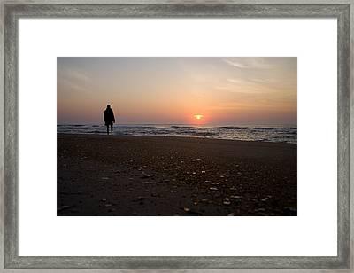 A Lone Figure Enjoys The Ocean Sunrise Framed Print by Stephen St. John