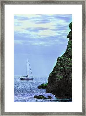 A Lone Sailboat Floats On A Calm Sea Framed Print