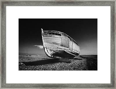 A Lonely Boat Framed Print