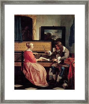 A Man And A Woman Seated By A Virginal Framed Print by Gabriel Metsu