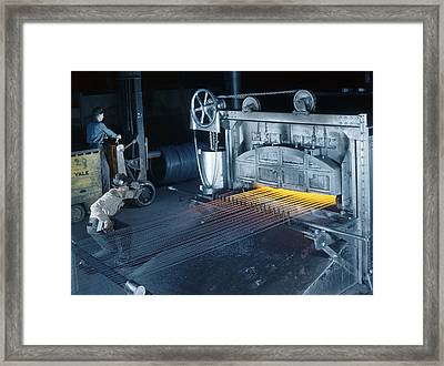 A Man Checks Temperatures Of Steel Rods Framed Print
