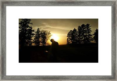 A Man In The Sunset Framed Print