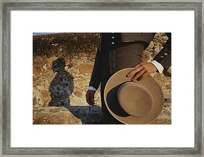 A Man In Traditional Dress Casts Framed Print by Raul Touzon