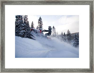 A Man Jumps Across A Road Framed Print by Taylor S. Kennedy