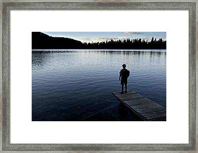 A Man Looking Across A Lake. Into Framed Print by Dawn Kish
