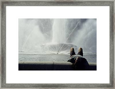 A Man Relaxes At A Fountain Framed Print by Stacy Gold
