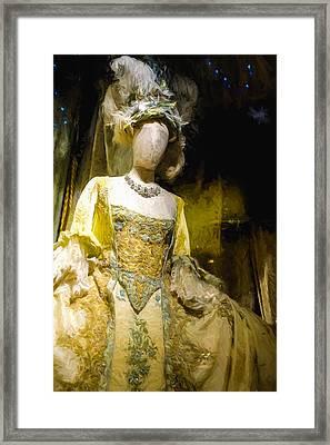 A Mannequin In A Grand Dress Framed Print by Paul Bucknall
