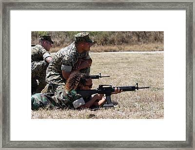 A Marine Explains The Proper Techniques Framed Print by Stocktrek Images