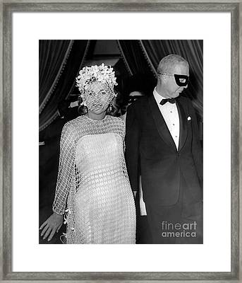 A Masquerade Ball For Actress, Joan Fontaine, And Her Guest. 1966 Framed Print by William Jacobellis