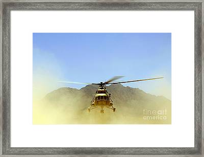 A Mi-17 Hip Helicopter Hovers Framed Print