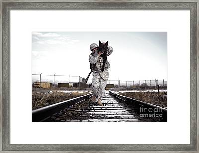 A Military Dog Handler Uses An Framed Print