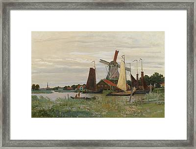 A Mill Zaandam Framed Print by Claude Monet