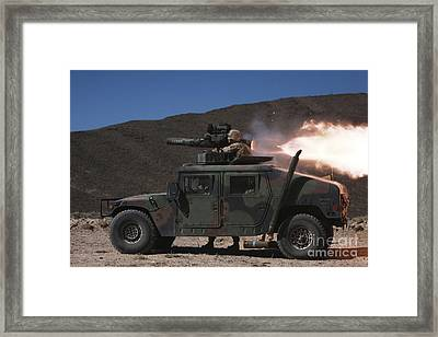 A Missileman Firing A Bgm-71 Tow Framed Print by Stocktrek Images