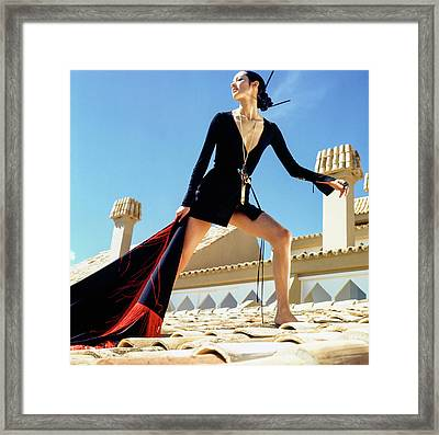 A Model On A Rooftop In A Dress By Paraphernalia Framed Print by Henry Clarke