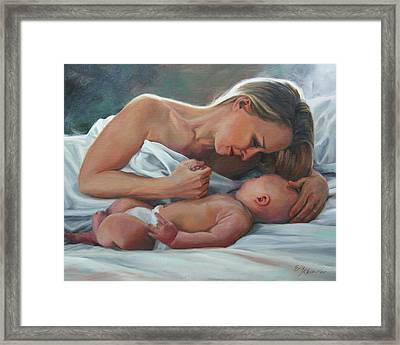 A Mother's Adoration Framed Print
