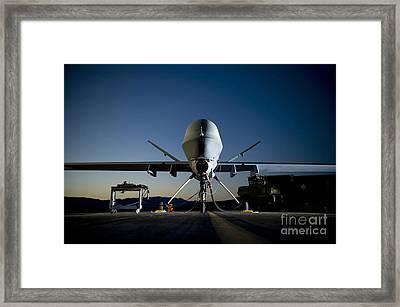 A Mq-9 Reaper Being Refueled Framed Print