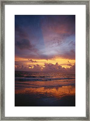 A Multi-hued Sunset Over Marco Island Framed Print by Raul Touzon