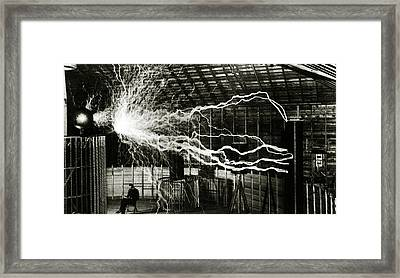 A Multiple Exposure Picture Of Tesla With His Magnifying Transmitter Framed Print by American School