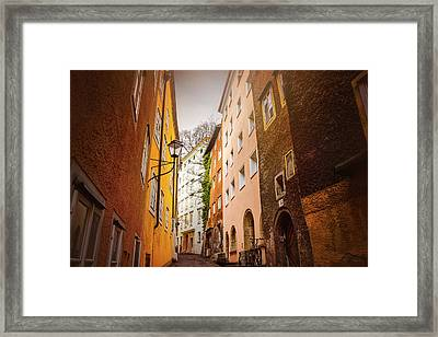 A Narrow Street In Salzburg  Framed Print by Carol Japp