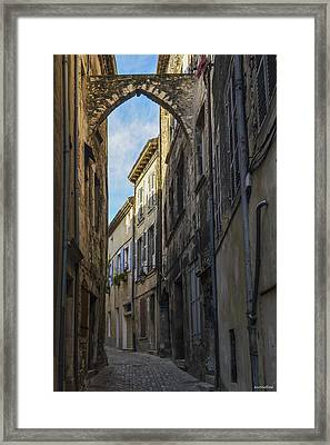 Framed Print featuring the photograph A Narrow Street In Viviers by Allen Sheffield