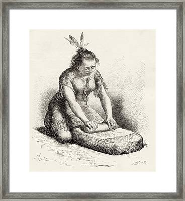 A Native Guayan Woman Crushing Grain Framed Print by Vintage Design Pics