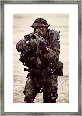 A Navy Seal Exits The Water Armed Framed Print