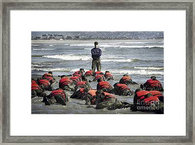 A Navy Seal Instructor Assists Students Framed Print