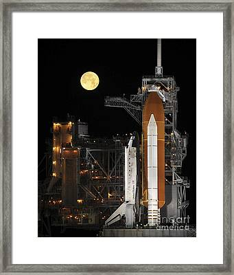 A Nearly Full Moon Sets As Space Framed Print by Stocktrek Images