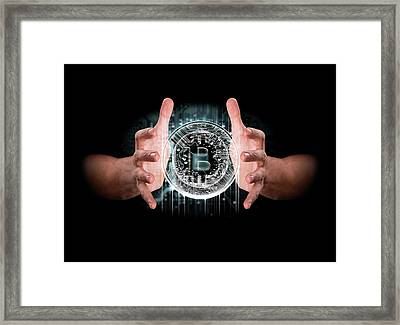 A Pair Of Male Hands Enveloping A Hologram Of A Bitcoin On An Isolated Dark Background Framed Print