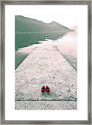 A Pair Of Red Women's Shoes Lying On A Walkway That Leads Into A Framed Print by Joana Kruse