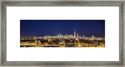 A Panoramic Look At The Chicago Skyline At Dusk Framed Print by Sven Brogren