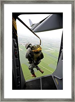 A Paratrooper Executes An Airborne Jump Framed Print by Stocktrek Images