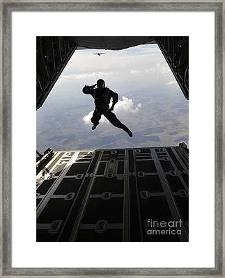 A Paratrooper Salutes As He Jumps Framed Print