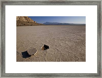 A Parched Lake Bed Below Notch Peak Framed Print by Bill Hatcher