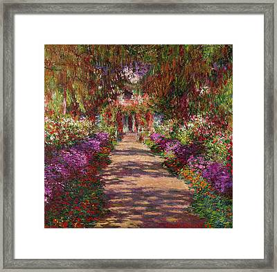 A Pathway In Monets Garden Giverny Framed Print by Claude Monet